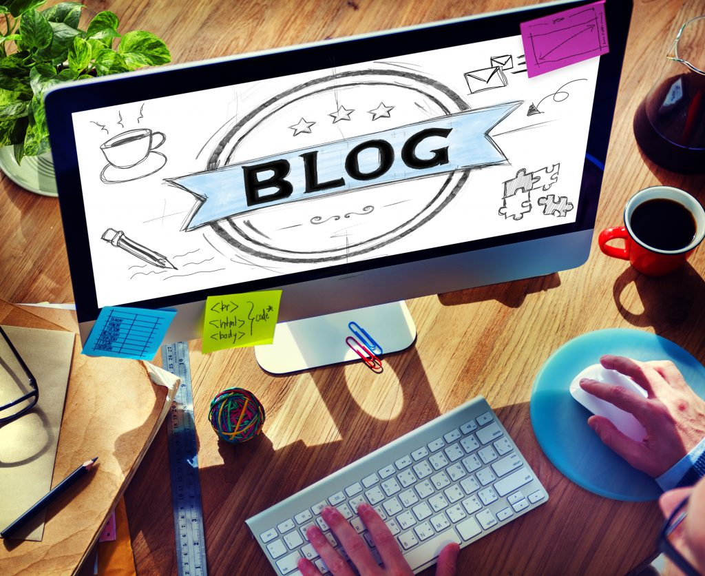 Person Making a Blog using a Desktop